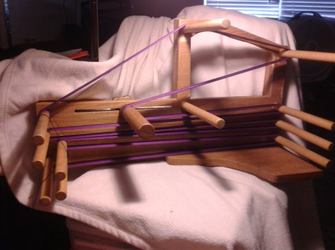 My inkle loom, warped with black and purple size 10 crochet cotton.