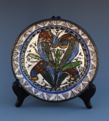 "A hand-thrown Maiolica plate glazed in the 15th century Italian Gothic ""severno"" style."