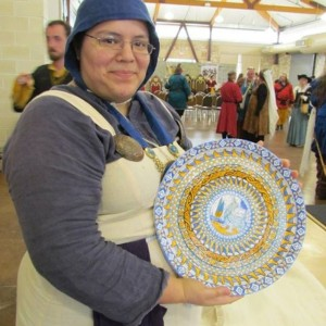 Me displaying the finished 15 inch wheel-thrown maiolica plate